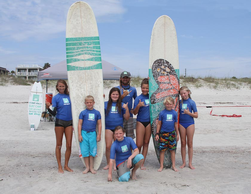 a surf school with instructors and children